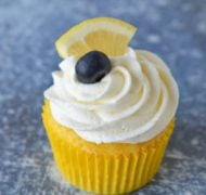 lemon buttercream frosting on cupcakes with lemon and blueberry