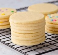 stacked sugar cookies on cooling rack