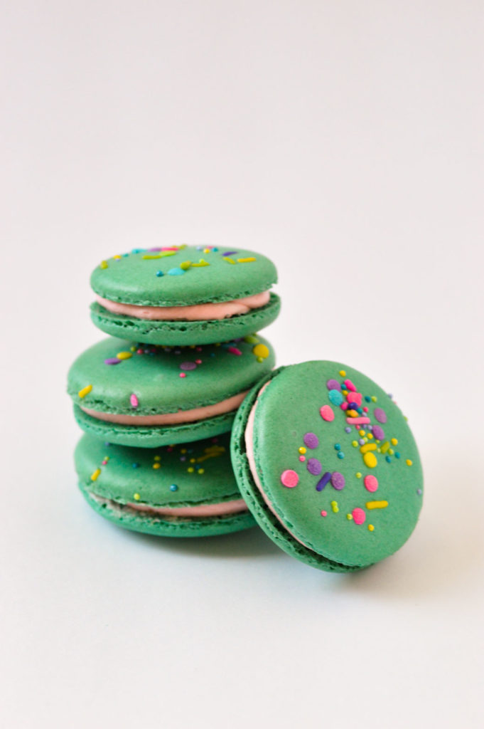 teal macarons with sprinkles