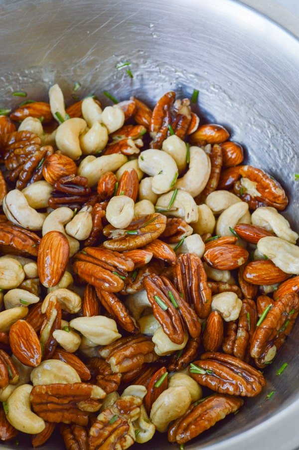 nuts unbaked in bowl with roasting glaze