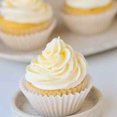 lemon buttercream with sprinkles on cupcake