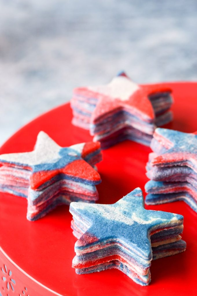 red white and blue marble sugar cookies on red cake stand