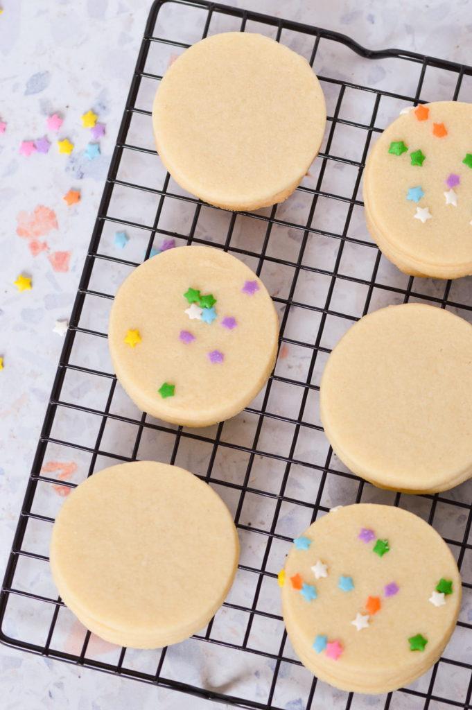baked sugar cookies on cooling rack