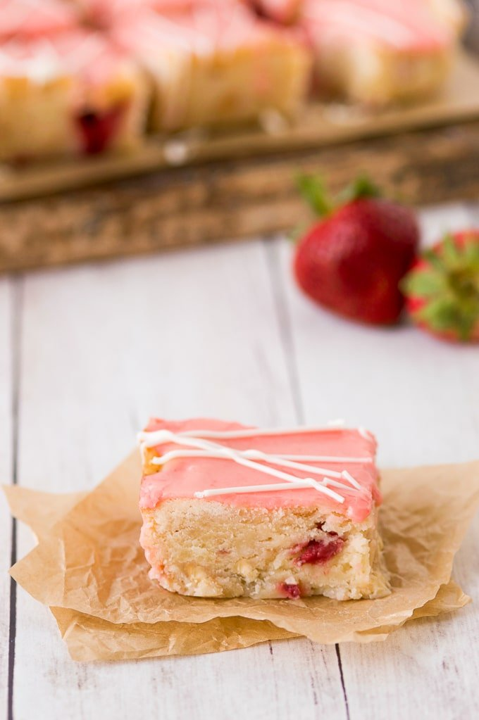 strawberry lemon blondie with pink glaze up close