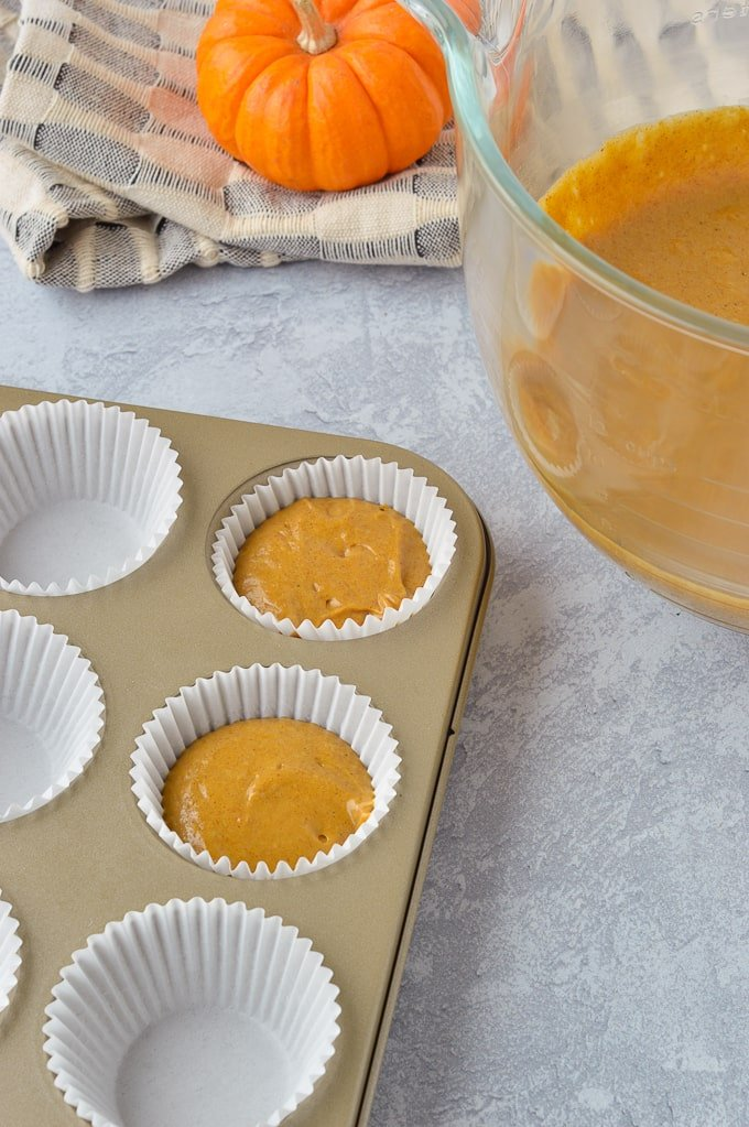pumpkin spice cupcakes unbaked in cupcake tins