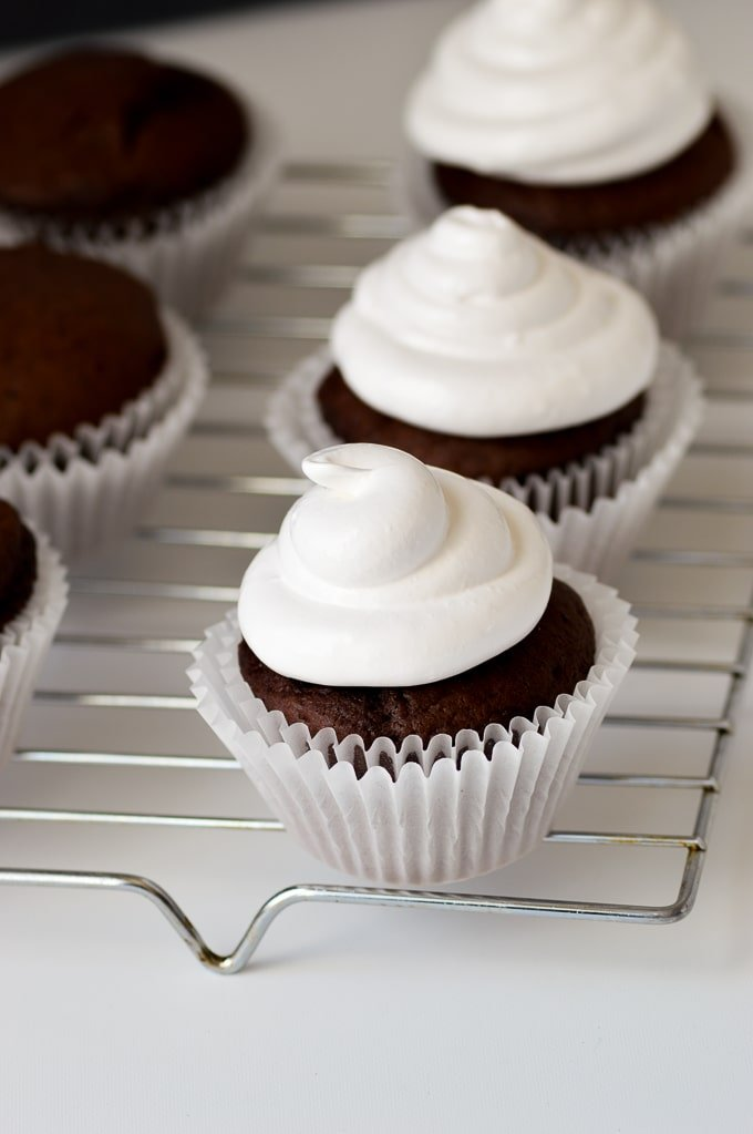 marshmallow frosting on top of chocolate cupcakes