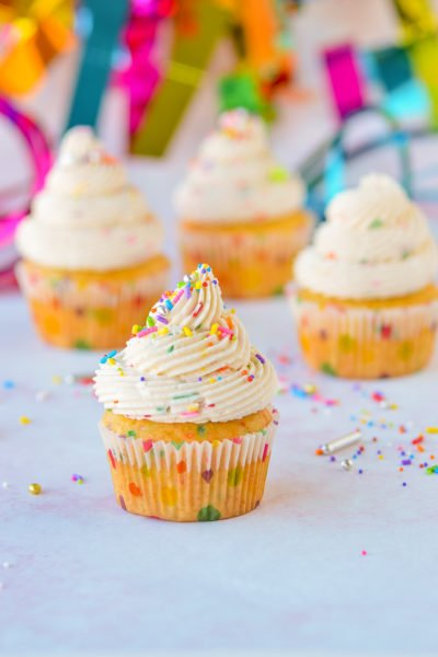 cake batter frosting on cupcakes with sprinkles