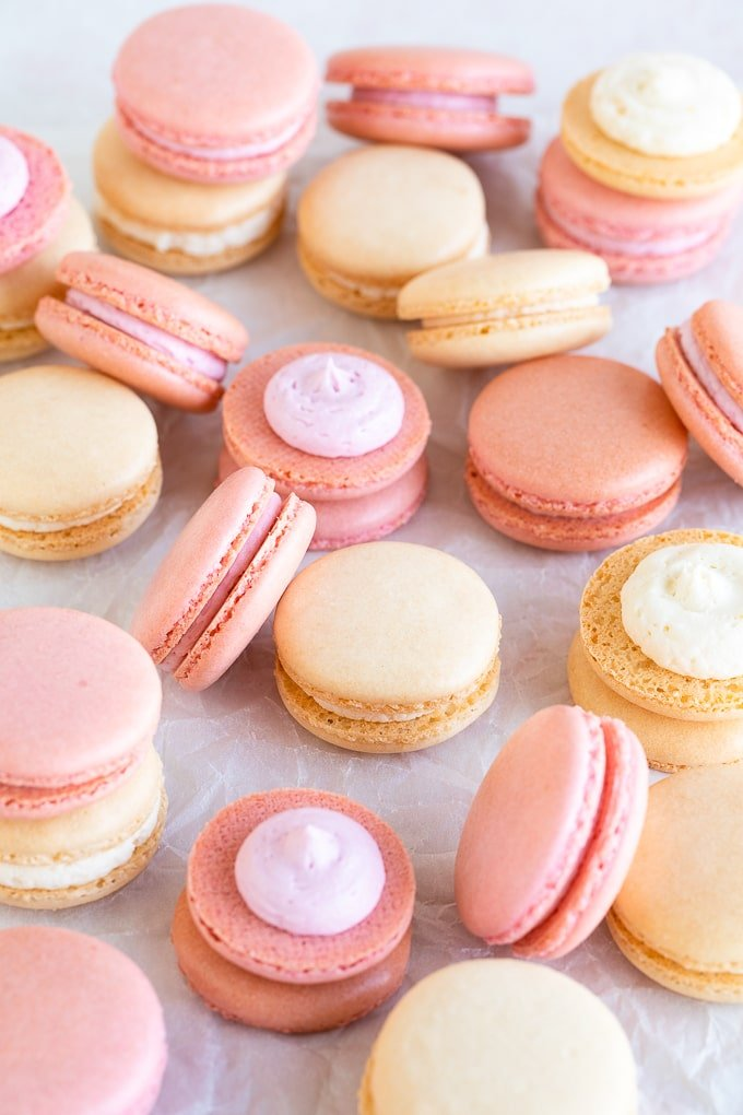pink and white macarons on parchment