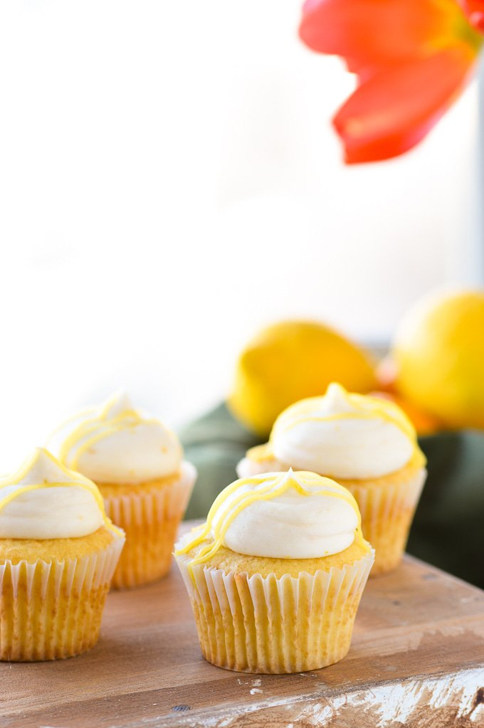 lemon buttercream frosting on cupcakes by window
