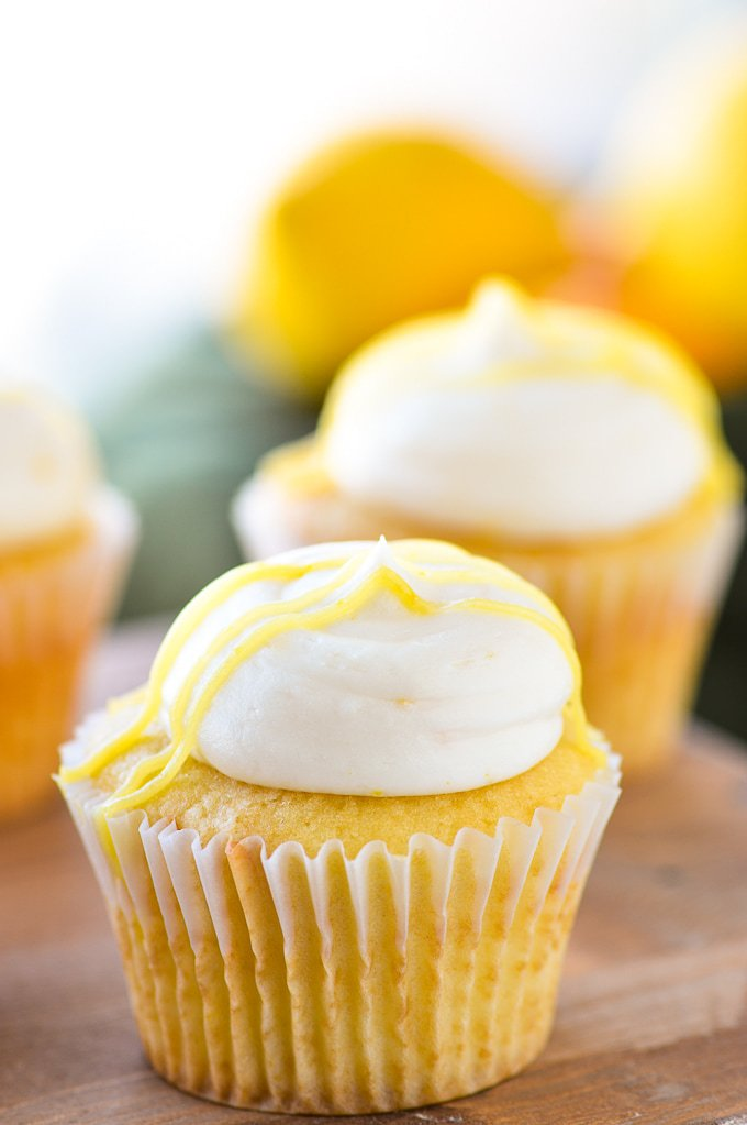 lemon buttercream frosting on yellow cupcake