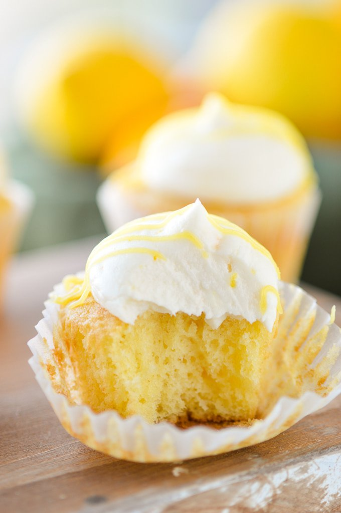 lemon frosting on cupcake with bite out of it